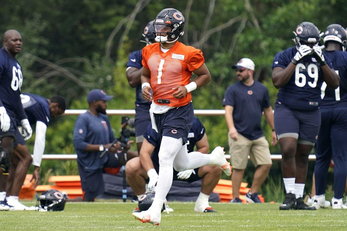 Bears quarterback Justin Fields runs in practice in late July.