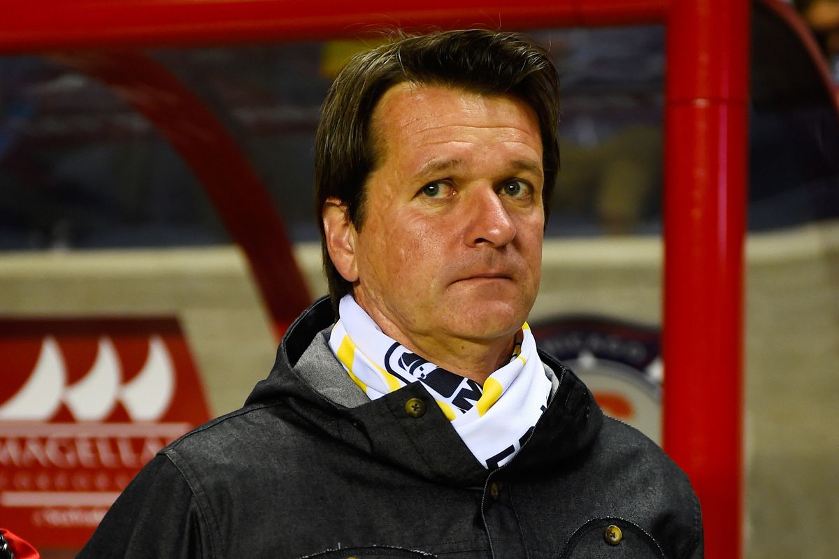 Frank Yallop. He's probably wearing a tie. He likes ties.