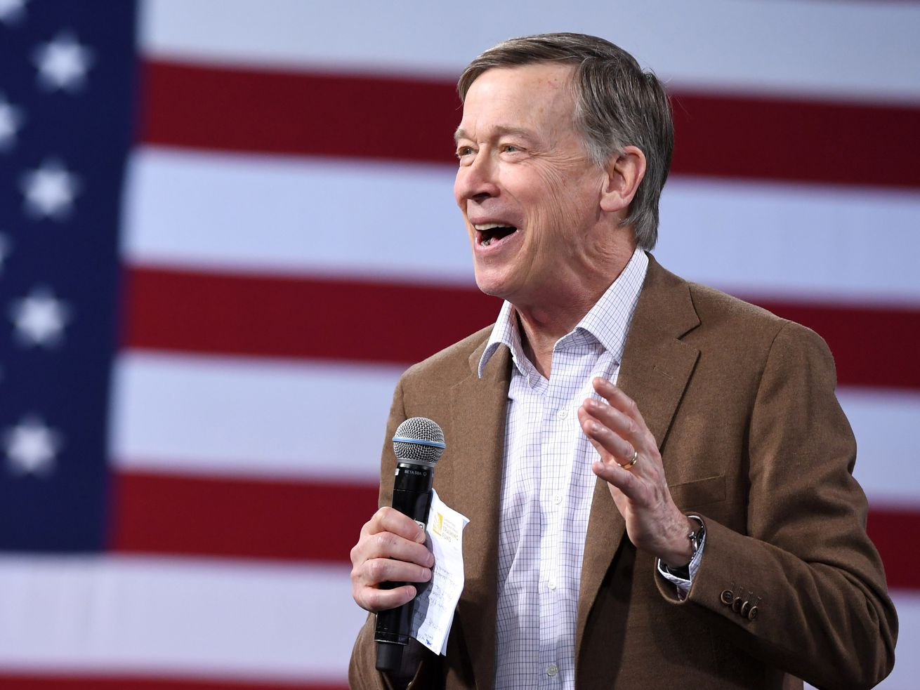 Former Colorado Gov. John Hickenlooper speaks at the National Forum on Wages and Working People in April in Las Vegas.