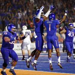 Boise State players celebrate recovering a fumble by BYU during NCAA football in Boise, Thursday, Sept. 20, 2012.