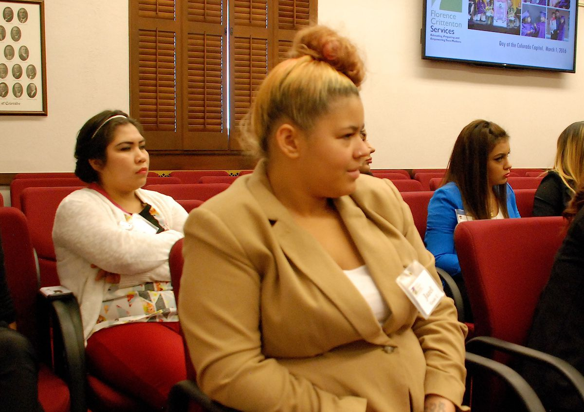 Florence Crittenton students listen to a legislator in a hearing room.