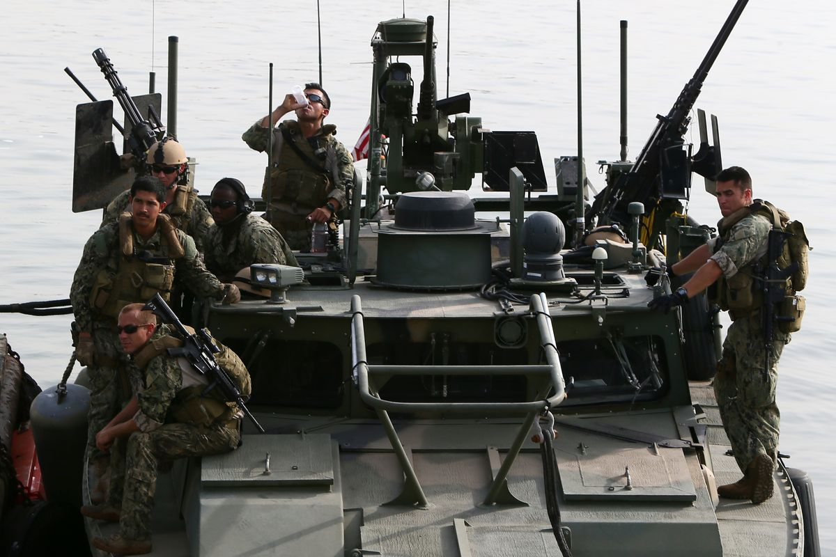 US sailors on a riverine command boat in Bahrain, the type of ship that Iran detained and then released.