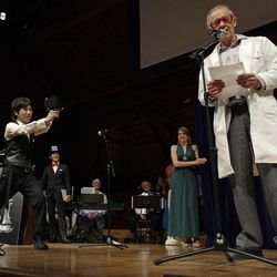 """Koji Tsukada, left, fires his invention the """"SpeechJammer"""" at 1986 Nobel Prize laureate for Chemistry Dudley Herschbach during a performance at the Ig Nobel Prize ceremony at Harvard University, in Cambridge, Mass., Thursday, Sept. 20, 2012. The Ig Nobel prize is an award handed out by the Annals of Improbable Research magazine for silly sounding scientific discoveries that often have surprisingly practical applications."""