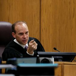 Judge Derek Pullan presides over the trial of Martin MacNeill  in Provo's 4th District Court on Tuesday, Nov. 5, 2013. MacNeill is charged with murder in the 2007 death of his wife, Michele MacNeill.