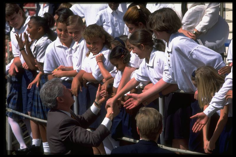 President Bill Clinton meets Long Beach students wearing school uniforms. The school district required students to wear uniforms partly due to concerns about gang violence.