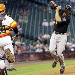 Pittsburgh Pirates first baseman Garrett Jones (46) avoids being hit by a foul ball hit by starting pitcher A.J. Burnett as Houston Astros catcher Chris Snyder (18) runs down the third base line during the fourth inning of a baseball game, Sunday, Sept. 23, 2012, in Houston.
