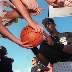 1-14-98–Michael Jordan signs autographs along the outfield wall at the White Sox training facility in Sarasota, Florida during his tryout with the Sox in 1994. Photo by Tom Cruze.