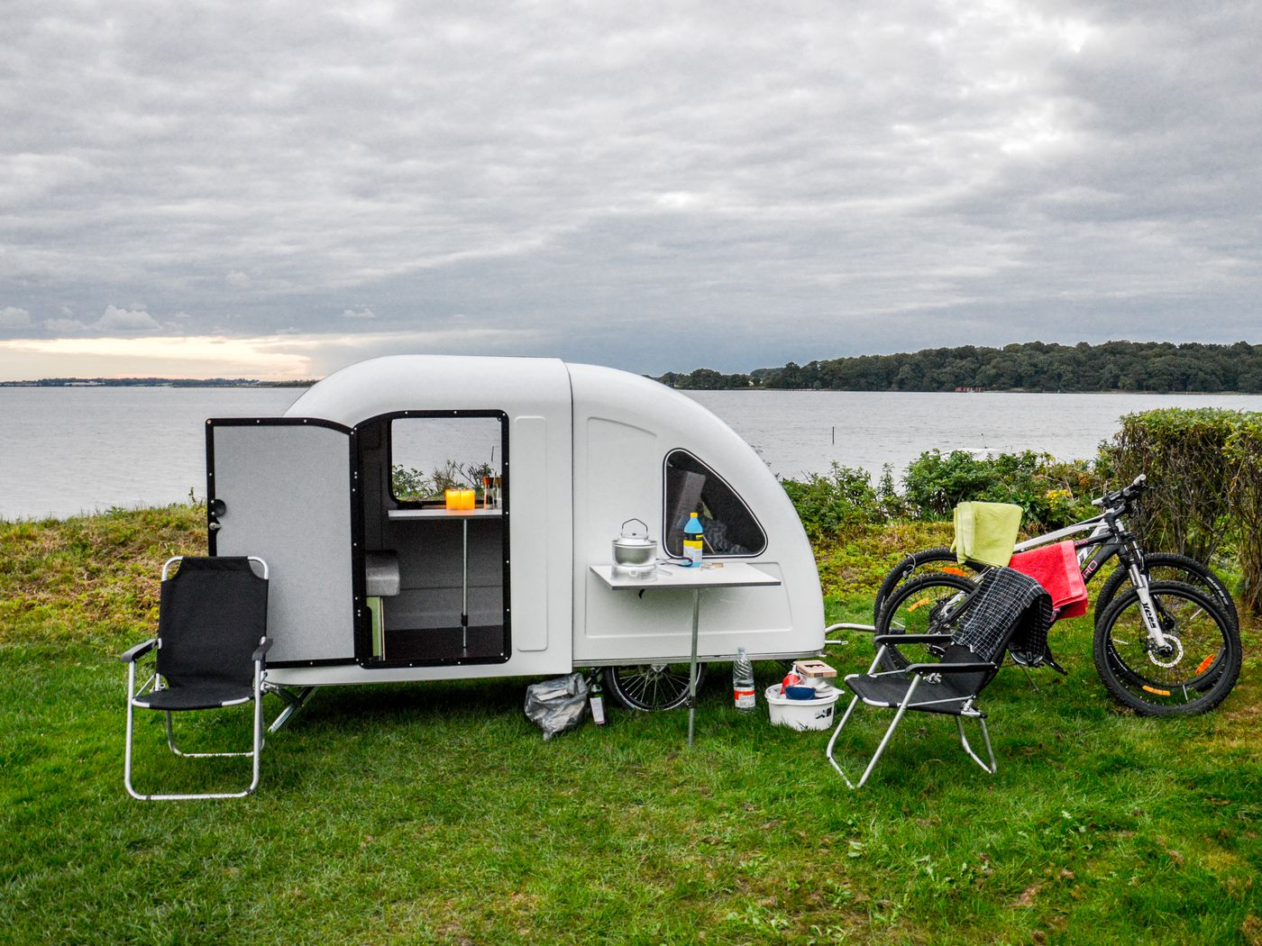 This tiny camper trailer is pulled by a bike - Curbed