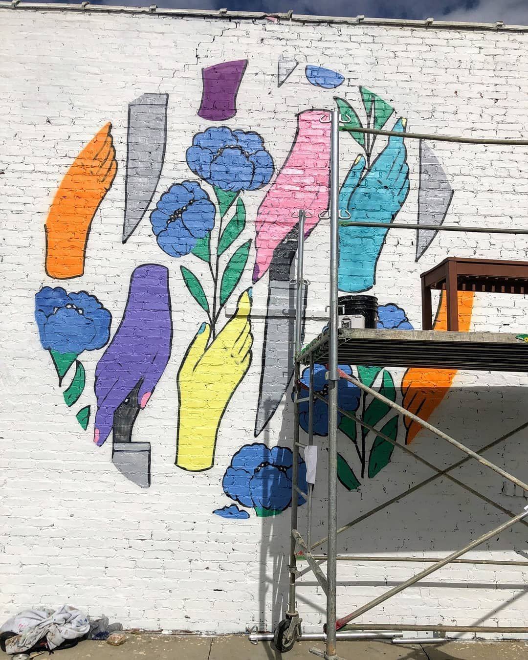 The mural by Kayleen Scott is locate just to the right of where the car entered the building