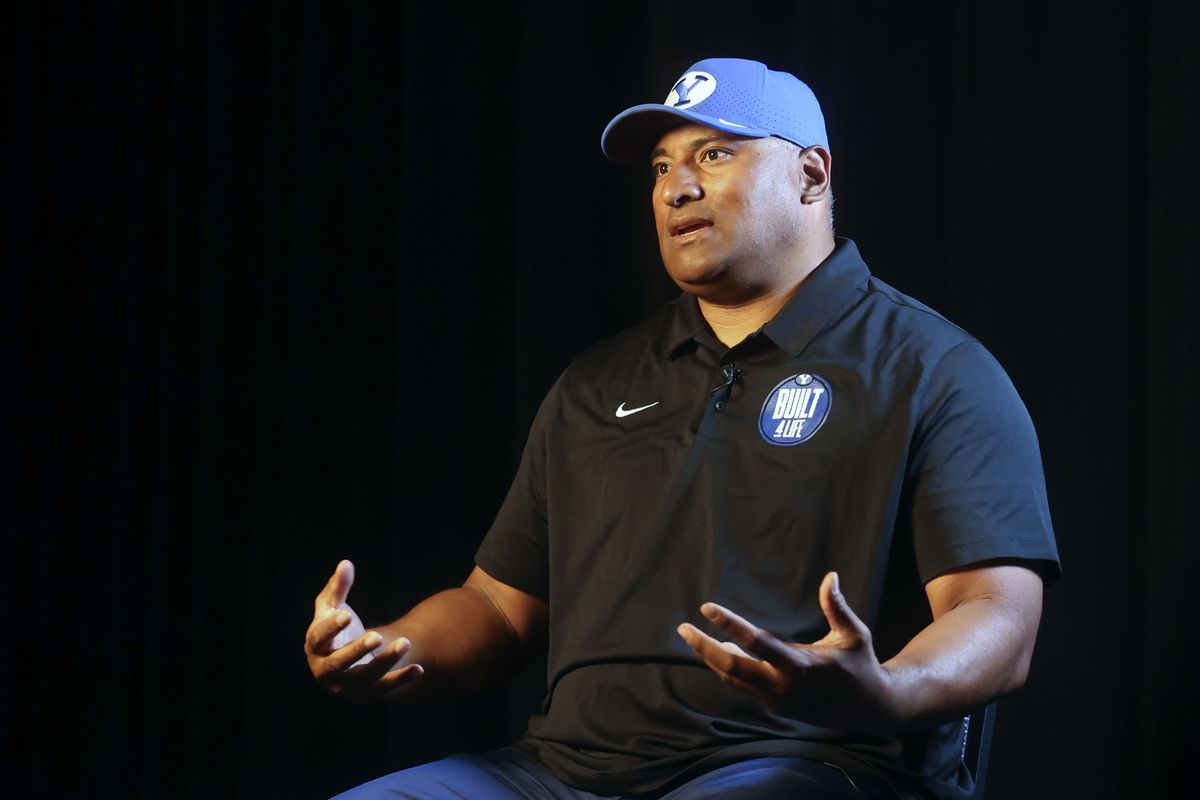 BYU head football coach Kalani Sitake answers interview questions during BYU Football Media Day.