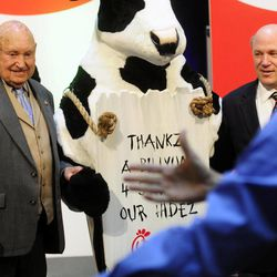 In this Monday, Dec. 14, 2009 picture, Chick-fil-a founder Truett Cathy, left, and his son Dan Cathy pose for a photo with the Chick-fil-A cows during a celebration of passing the $3 billon dollar mark in system-wide sales for the first time at the Chick-fil-a headquarters in Atlanta.