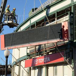 3:15 p.m. The third segment of the marquee being lowered onto the ground -