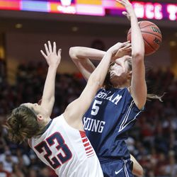 Brigham Young Cougars center Jennifer Hamson (5) is fouled by Gonzaga Bulldogs forward Kiara Kudron (23) during the West Coast Conference championship game in Las Vegas Tuesday, March 11, 2014. BYU lost 71-57.