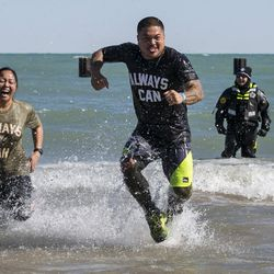 Thousands jump in the freezing waters of Lake Michigan for the 18th Annual Chicago Polar Plunge at North Avenue Beach on Sunday, March 4, 2018.   Ashlee Rezin/Sun-Times