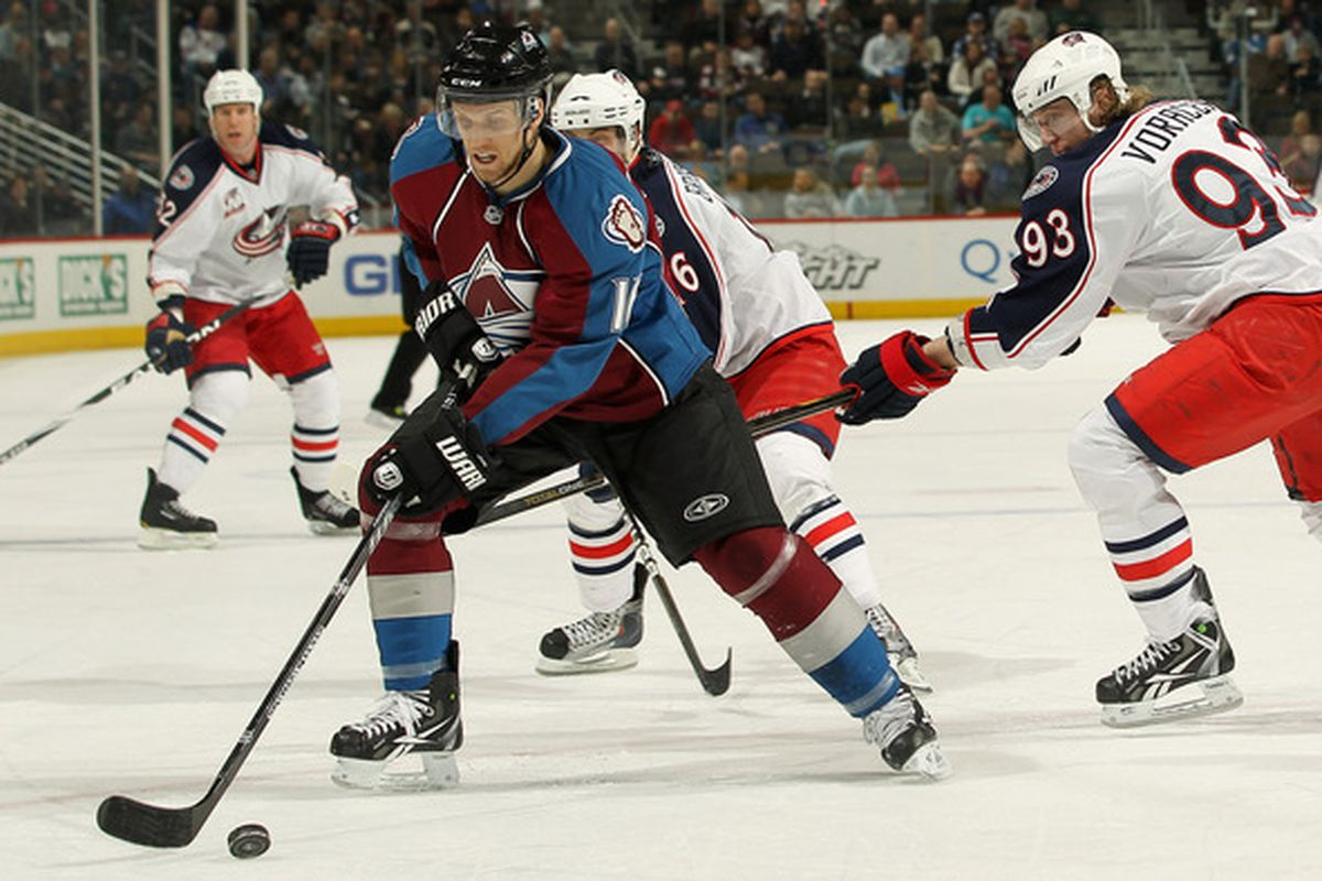 DENVER, CO - MARCH 22:  Jonas Holos #36 of the Colorado Avalanche steal the puck from Jacob Voracek #93 of the Columbus Blue Jackets at the Pepsi Center on March 22, 2011 in Denver, Colorado.  (Photo by Doug Pensinger/Getty Images)