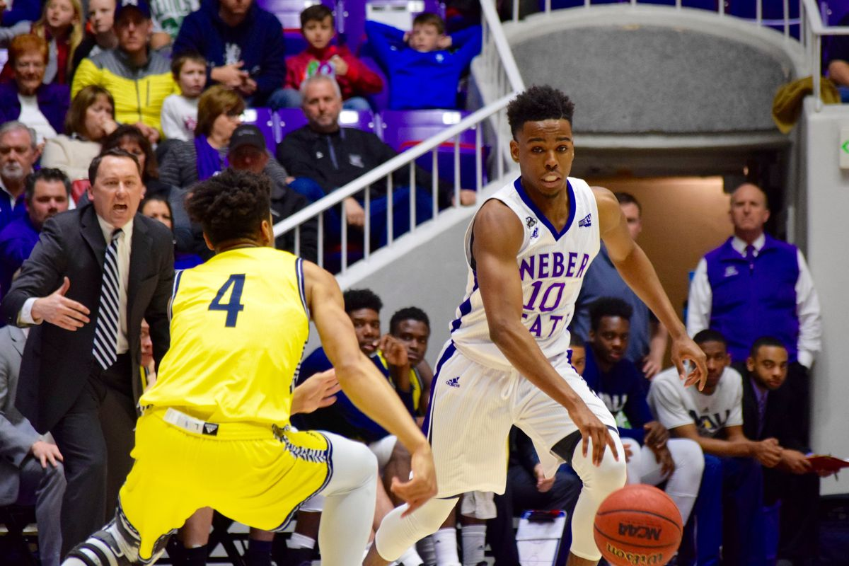 FILE: Weber State freshman Jerrick Harding dribbles past Northern Arizona's JoJo Anderson in a game at the Dee Events Center last season. Harding led the Wildcats to a 96-74 win over Arkansas-Pine Bluff on Saturday night.