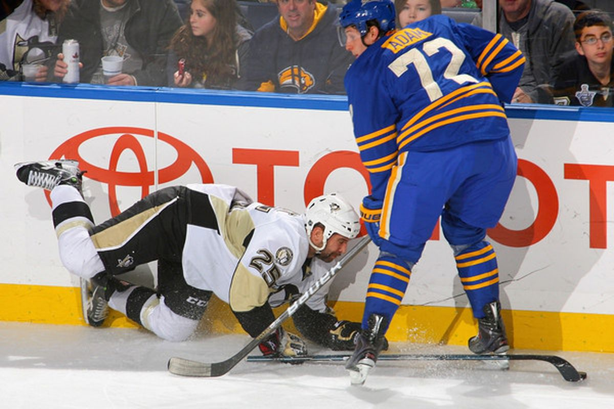 BUFFALO NY - DECEMBER 11: Maxime Talbot #25 of the Pittsburgh Penguins falls into Luke Adam #72 of the Buffalo Sabres at HSBC Arena on December 11 2010 in Buffalo New York.  (Photo by Rick Stewart/Getty Images)
