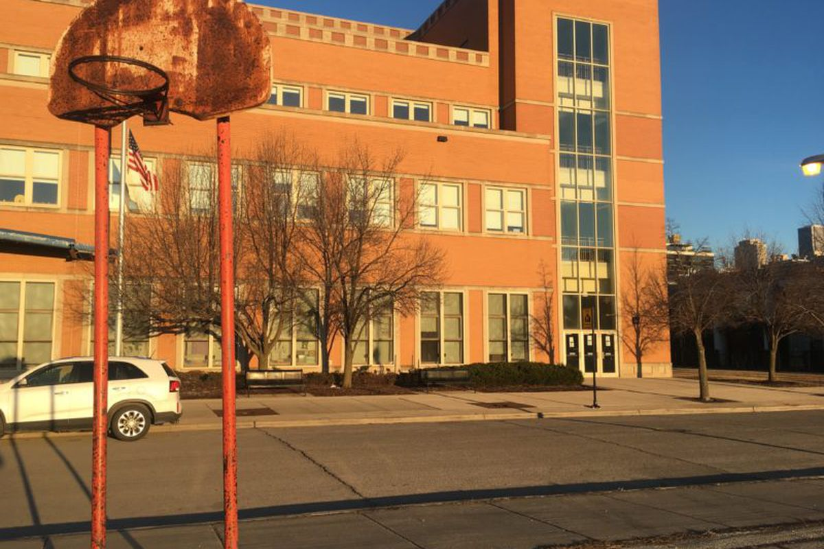 A rusted basketball goal across the street from the Jenner campus is a reminder of the Cabrini-Green community that at its peak totaled at least 15,000 people. The demolition of Cabrini-Green and subsequent gentrification decreased enrollment at the schools in the area, leading to closures.