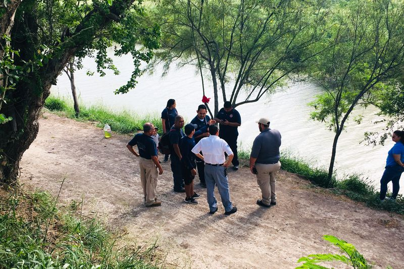 Mexican authorities stand along the Rio Grande bank where the bodies of Salvadoran migrant Oscar Alberto Martínez Ramírez and his nearly 2-year-old daughter Valeria were found, in Matamoros, Mexico, Monday, June 24, 2019, after they drowned trying to cros
