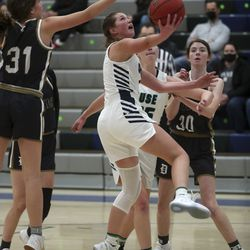 Action in the Davis at Syracuse girls basketball game in Syracuse on Tuesday, Feb. 9, 2021.