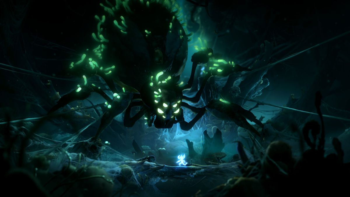 A giant spider stands atop the main character in Ori and the Will of the Wisps
