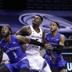 BYU's Gideon George (5) battles for position with New Orleans' Damion Rosser (1) during the Cougars' 86-61 win over the New Orleans Privateers at the Marriott Center in Provo on Thursday, Nov. 26, 2020.