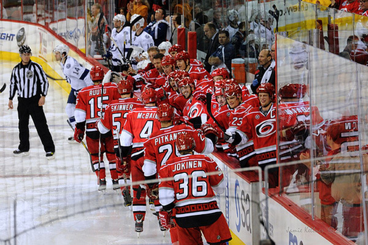 The bench congratulates Jeff Skinner on his first of two goals in a 4-2 win against the Tampa Bay Lightning on November 1, 2011 (author's photo, all rights reserved).