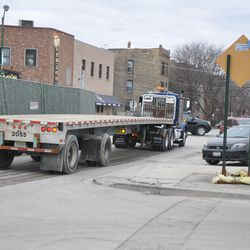 Cars moving out of the way as trailer truck heads west on Waveland -