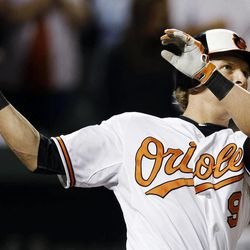 Baltimore Orioles' Nate McLouth watches his single in the ninth inning of a baseball game against the Tampa Bay Rays in Baltimore, Wednesday, Sept. 12, 2012. Manny Machado scored on the play, and Baltimore won 3-2.