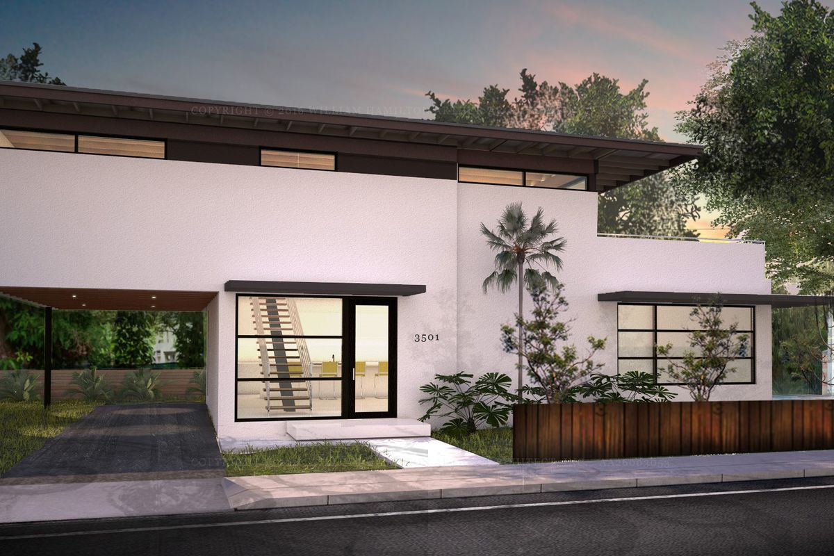 A modern home in Coconut Grove with wood paneling and big windows