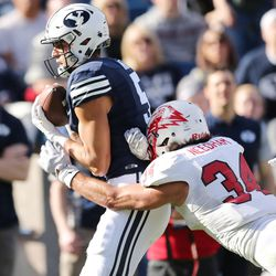 Brigham Young Cougars wide receiver Nick Kurtz (5) catches a touchdwon past Southern Utah Thunderbirds linebacker Mike Needham (34)  in Provo on Saturday, Nov. 12, 2016.
