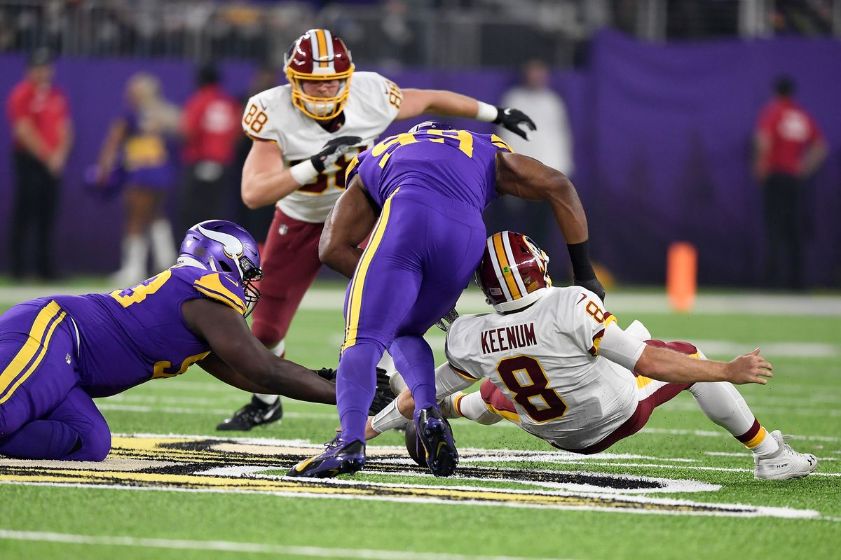 Washington quarterback Case Keenum fumbles the ball and is recovered by Shamar Stephen of the Minnesota Vikings during the game at U.S. Bank Stadium on October 24, 2019 in Minneapolis, Minnesota.