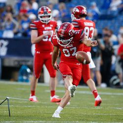 Utah players warm up ahead of an NCAA college football game against BYU at LaVell Edwards Stadium in Provo on Saturday, Sept. 11, 2021.