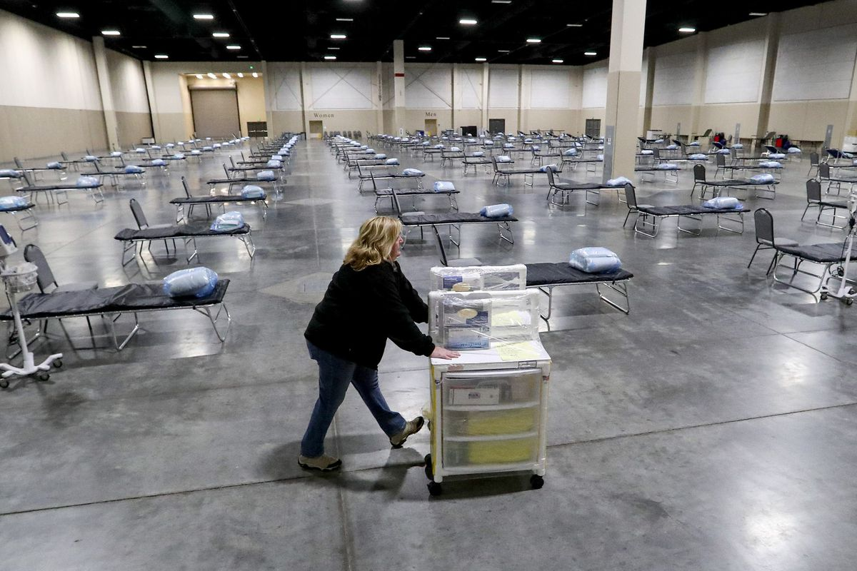 Jan Robinette, an emergency medical technician with the Utah Health Emergency Response Team, pushes an isolation cart inside the Mountain America Expo Center t in Sandy on Monday, April 6, 2020. The state contracted with Salt Lake County to use the expo center as a hospital overflow facility for people needing hospital care that's not related to COVID-19 should the need arise during the pandemic.