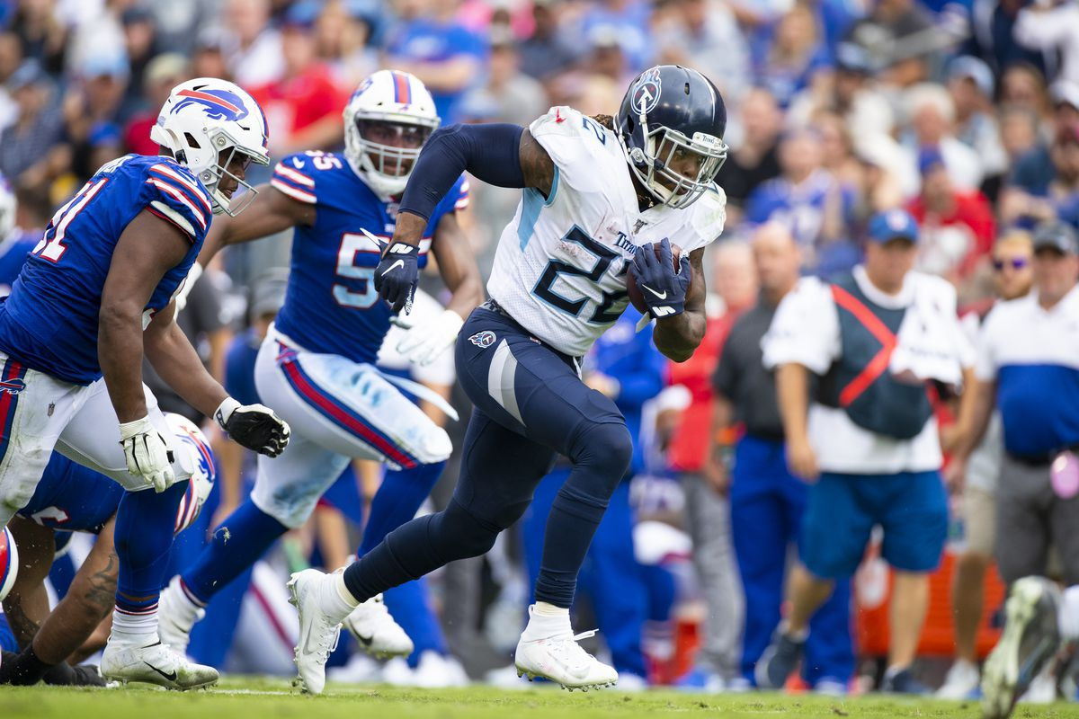 Derrick Henry of the Tennessee Titans carries the ball for a first down during the third quarter against the Buffalo Bills at Nissan Stadium on October 6, 2019 in Nashville, Tennessee.