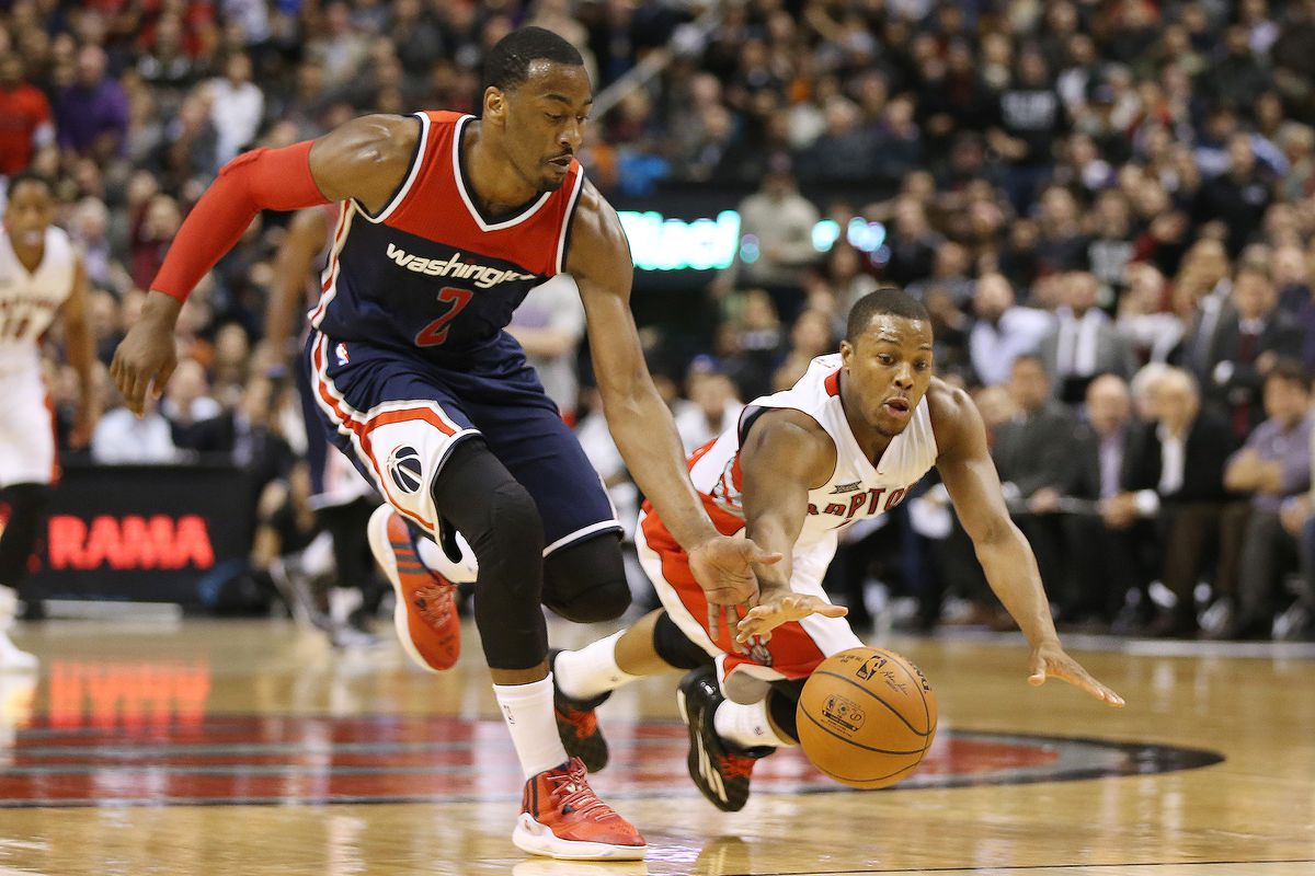 John Wall, left, and Kyle Lowry shared a backcourt in the All-Star Game, but they'll be sworn enemies come Saturday.