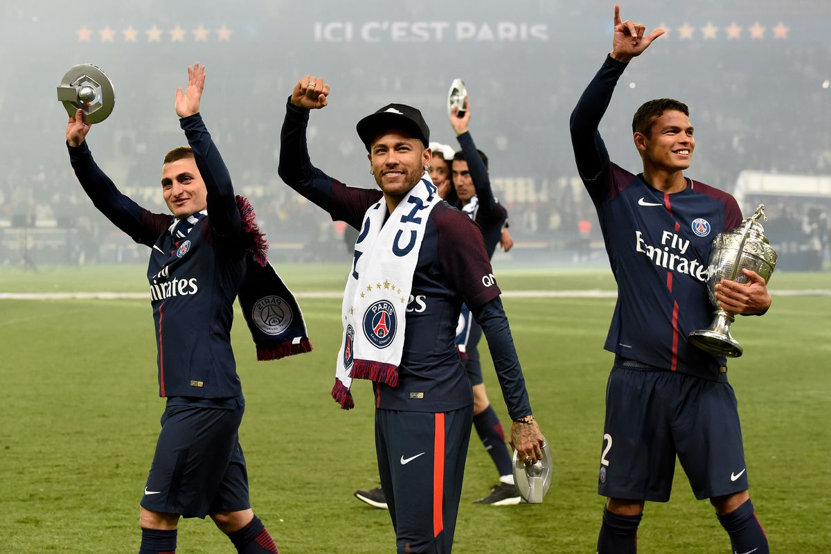 PARIS, FRANCE - MAY 12: (L-R) Marco Verratti of Paris Saint Germain, Neymar Jr of Paris Saint Germain, Thiago Silva of Paris Saint Germain celebrates the championship with the trophy during the French League 1 match between Paris Saint Germain v Rennes at the Parc des Princes on May 12, 2018 in Paris France.