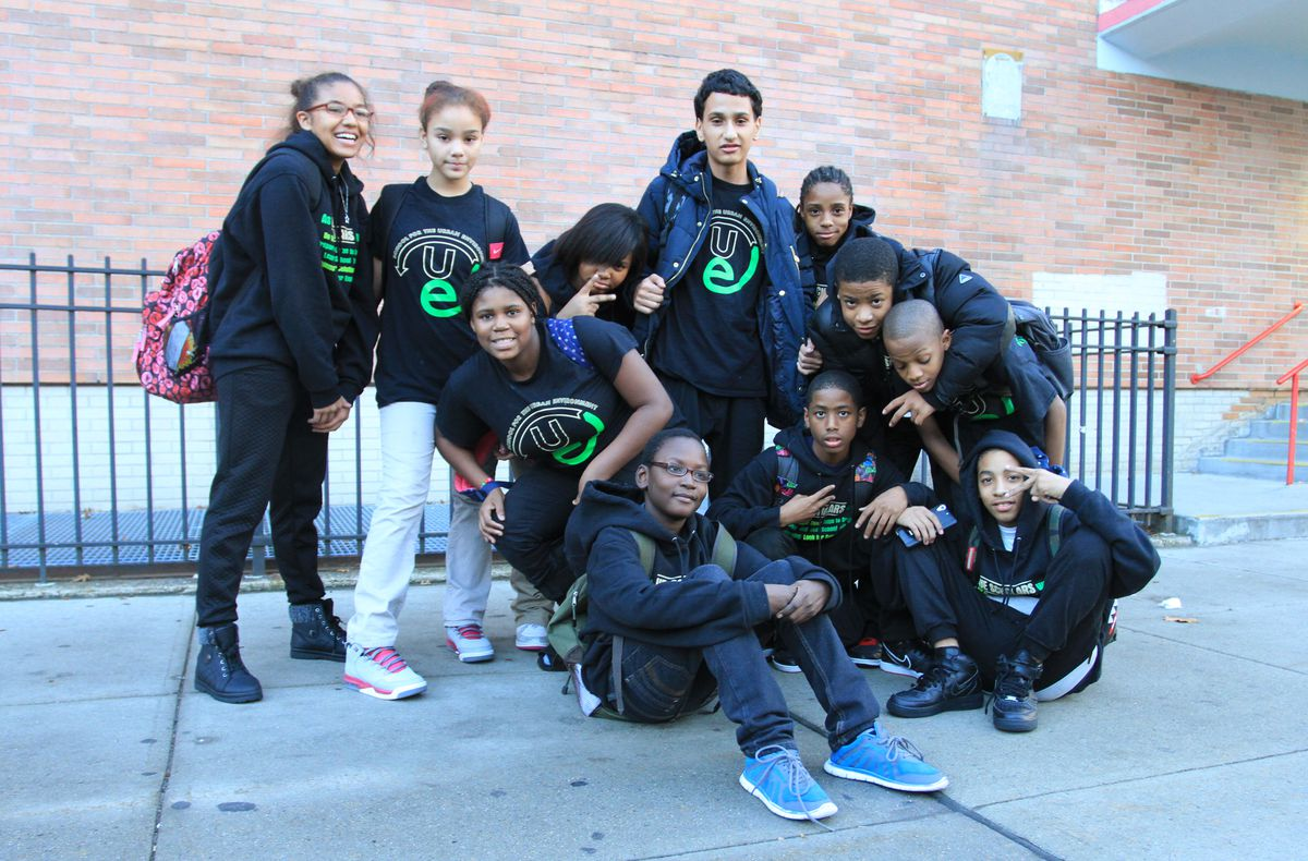 A group of middle school students hang out after school at the School for the Urban Environment, which is one of three schools the city is planning to close.