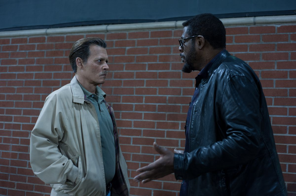 Johnny Depp scowling at Forest Whitaker in City of Lies