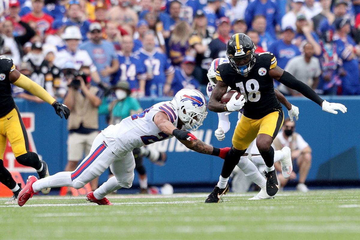 Taron Johnson #24 of the Buffalo Bills looks to tackle Diontae Johnson #18 of the Pittsburgh Steelers during the third quarter at Highmark Stadium on September 12, 2021 in Orchard Park, New York.