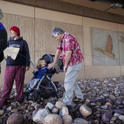 Pamela Atkinson and Ed Snoddy speak with a woman and her child as she panhandles under a highway overpass in West Valley City on Thursday, Nov. 24, 2016. Atkinson and Snoddy tried to convince the woman to leave the busy intersection for the safety of her daughter, but the woman refused. Atkinson called the police to have the woman removed from the intersection.
