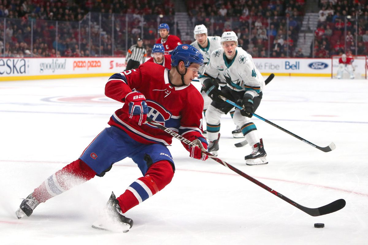 Dec 2, 2018; Montreal, Quebec, CAN; Montreal Canadiens center Jesperi Kotkaniemi (15) plays the puck against San Jose Sharks during the third period at Bell Centre. Mandatory Credit: Jean-Yves Ahern