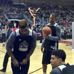 Rodney Hood listens to his USA teammates while the Jazz stunt team performs in the background as part of the NBA All-Star Weekend's Rising Stars Challenge on Friday, Feb. 12, 2016, at Air Canada Centre in Toronto.