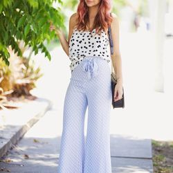 """Liz of <a href=""""http://www.lateafternoonblog.com""""target=""""_blank"""">Late Afternoon</a> is wearing a Tibi top, Reformation pants, a Chanel bag, Loeffler Randal shoes and Karen Walker sunglasses."""