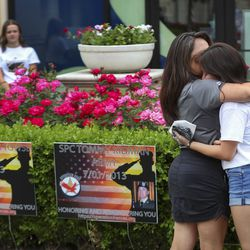 Antionette Stapley, left, hugs daughter Kennedy, after they placed a memorial sign in honor of Antoinette's late husband and Kennedy's father, Army 1st Sgt. Tracy L. Stapley, who died July 3, 2013, during a deployment to Qatar, as they set up for Operation Hero's drive-thru Memorial Day display at Station Park in Farmington on Friday, May 22, 2020. Kennedy Stapley joined her teammates on the Roy High School drill team as they placed 281 yard signs and 50 American flags in honor of Utah service members who have died while in service since Sept. 11, 2001. The signs include a hero's name, rank, military branch, angel date and a picture. Families are invited to drive or walk past the display.