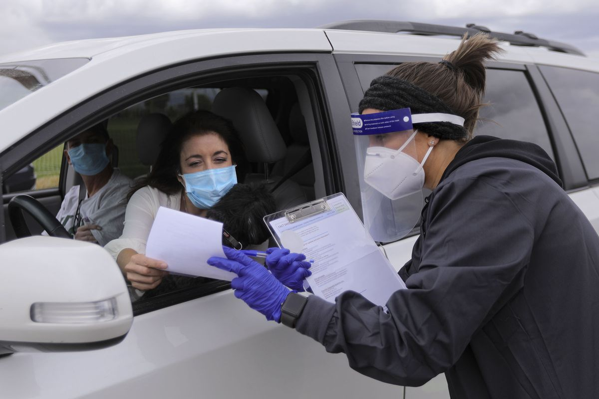 Nurse practitioner Lynette Evans, right, tells Jennifer Whitehead that she tested positive for COVID-19 antibodies at Galena Hills Park in Draper on Wednesday, May 20, 2020. Whitehead, a physician assistant, was very sick in February and was hoping the antibody results would come back as positive.
