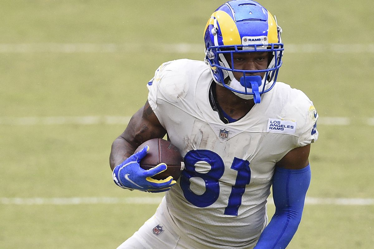 Gerald Everett #81 of the Los Angeles Rams runs with the ball in the first half against the Washington Football Team at FedExField on October 11, 2020 in Landover, Maryland.