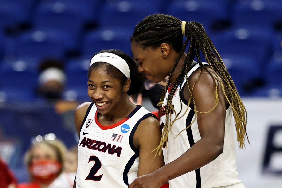 Aari McDonald and Trinity Baptiste of the Arizona Wildcats celebrate late in the fourth quarter after McDonald drew the foul against the Indiana Hoosiers during the Elite Eight round of the NCAA Women's Basketball Tournament at the Alamodome on March 29, 2021 in San Antonio, Texas.The Arizona Wildcats defeated the Indiana Hoosiers 66-53 to advance to the Final Four.