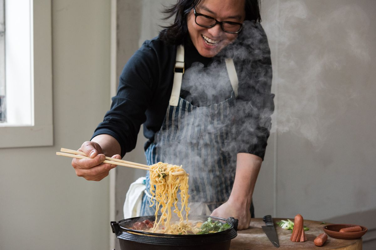 Peter Cho of Han Oak pulls noodles from a skillet