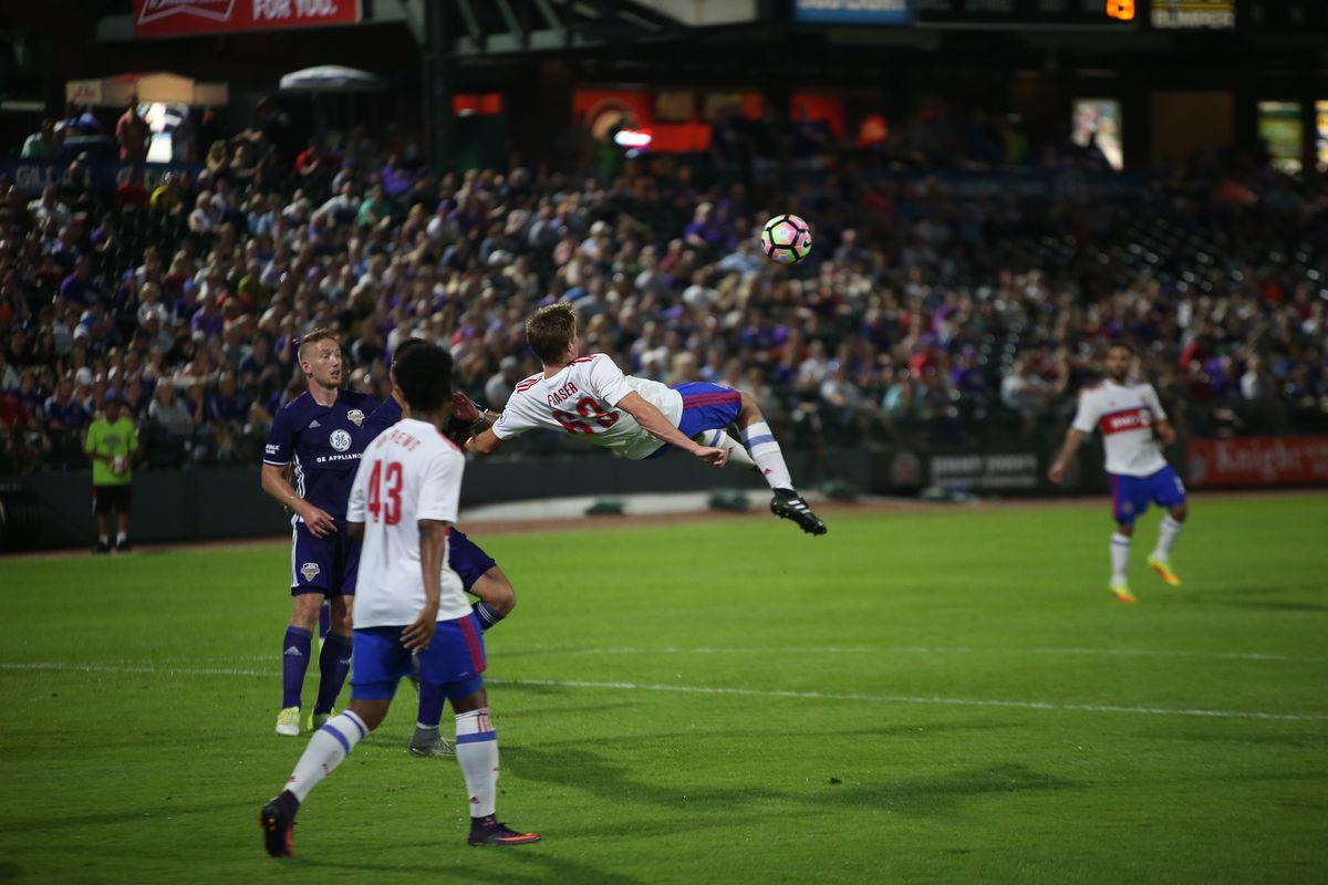USL match photo Liam Fraser gets airborne against Louisville City FC